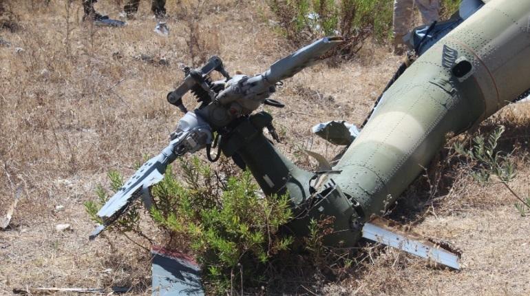 Следственный комитет России показал фотографии и видео с места крушения самолета СУ-24М и спасательного вертолета в Сирии в 2015 году.
